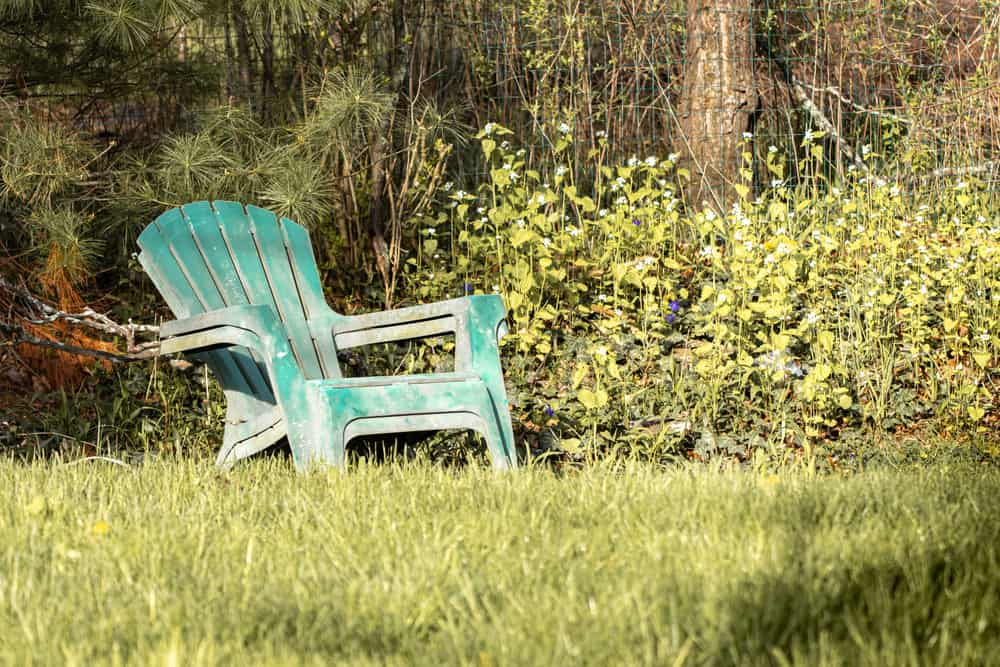 faded plastic chairs on lawn