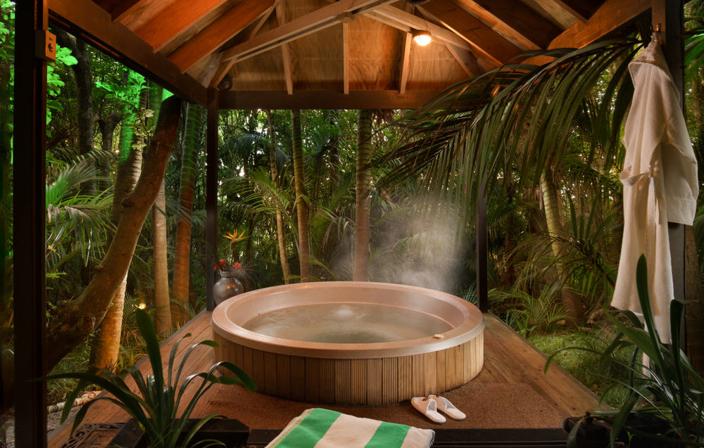 hot tub under a pagoda sitting in the palm forest