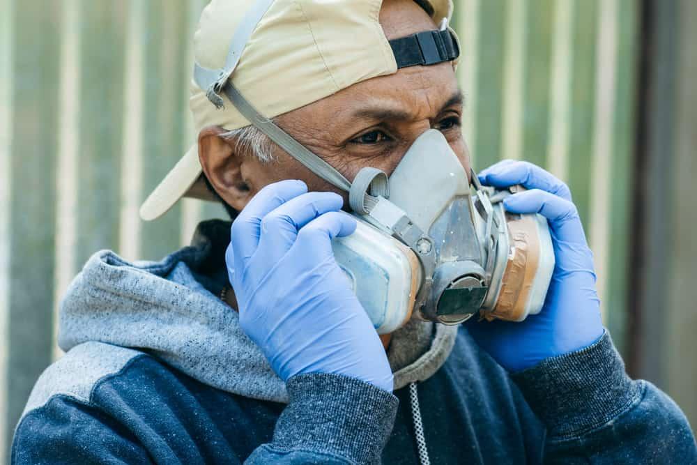 mane wearing face respirator