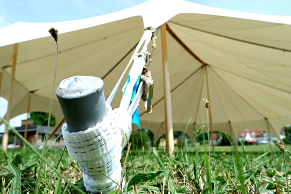 tent pegs and rope to secure a gazebo in the wind